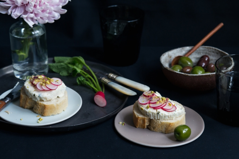 Boursin Shallot Chive on french bread with radishes