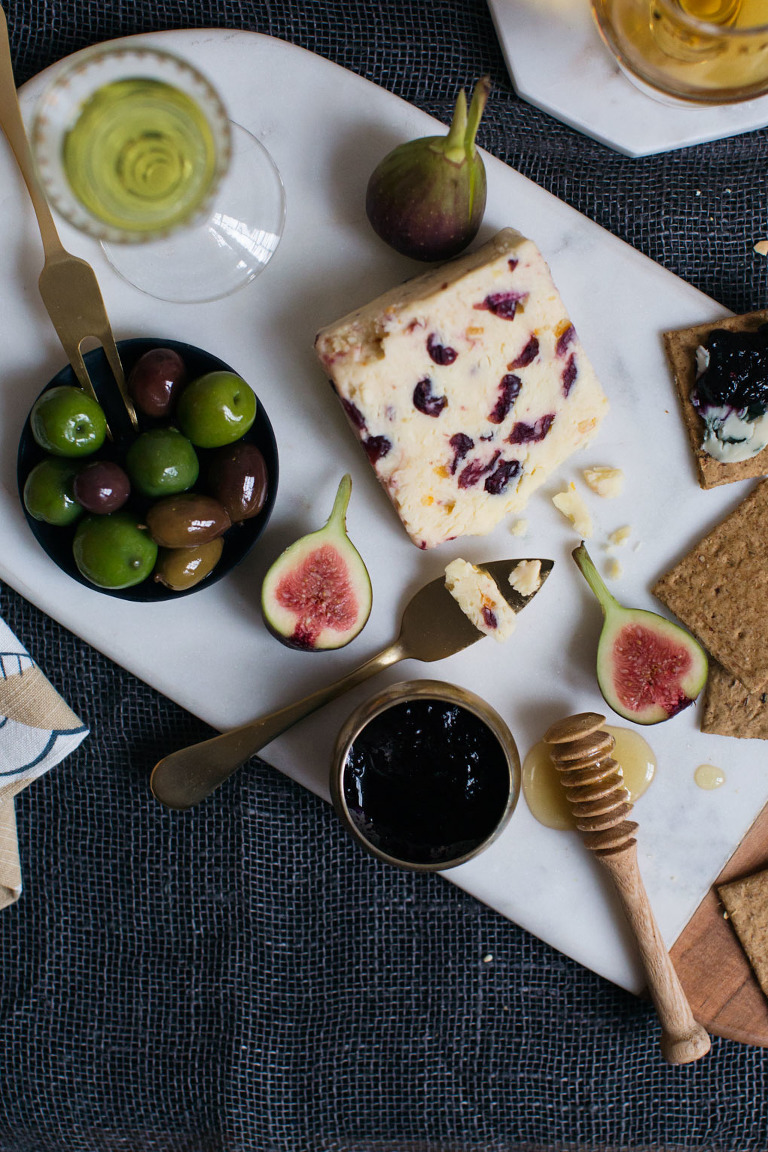 Festive cheese plate styled with West Elm products photo