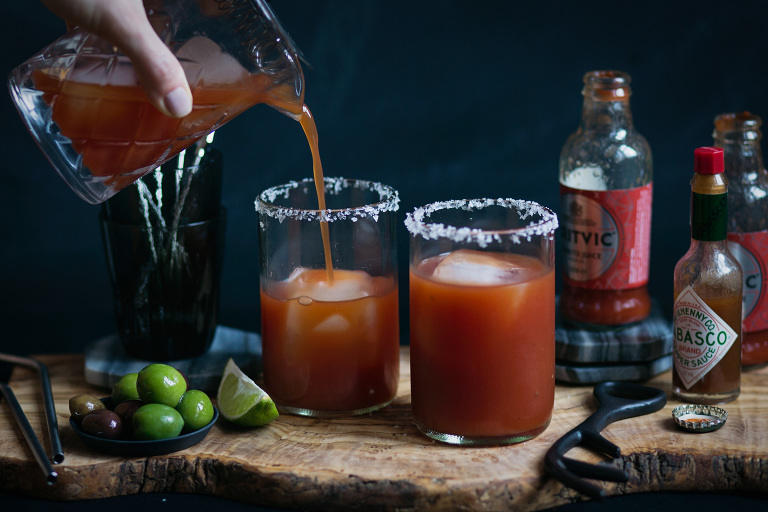 pouring beer bloody mary cocktail photo