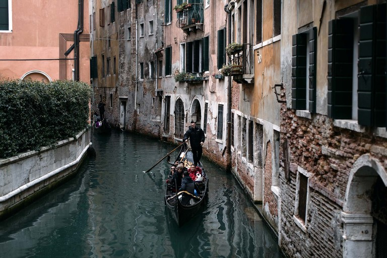 Venice canal and gondola photo